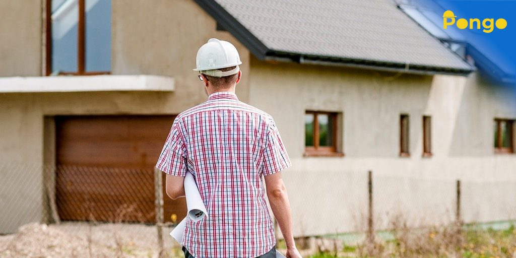 Construction worker outside a house